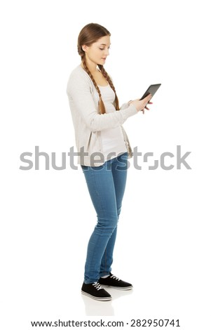 Teenage woman holding tablet computer.