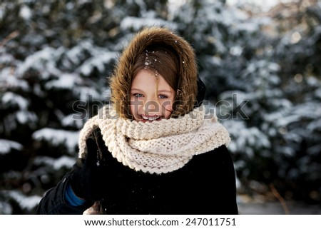 Teenage woman in winter clothes outdoor - stock photo