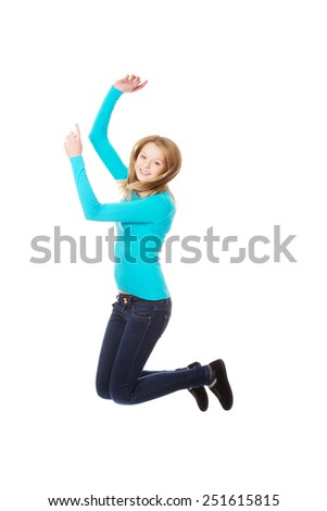 Teenage woman jumping with joy - stock photo