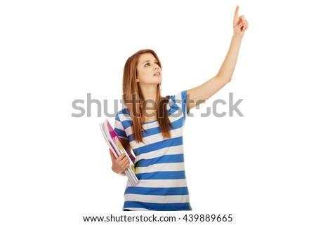 Teenage woman showing copyspace or something - stock photo