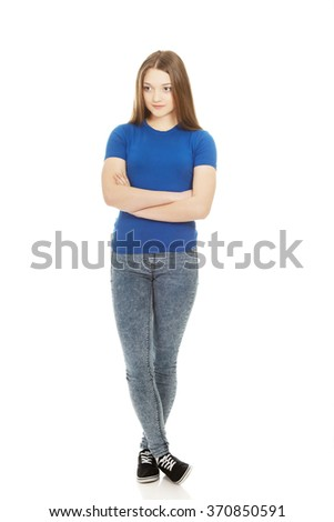 Teenage woman with crossed arms. - stock photo