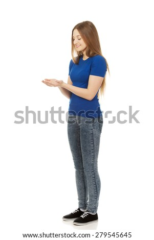 Teenage woman with open hands - stock photo