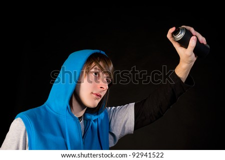 Teenager about to use a can of spray - stock photo