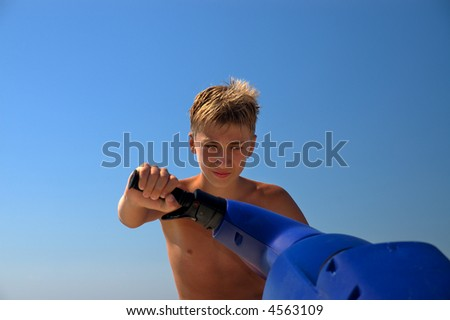 teenager and a water motorcycle on background of the blue sky.