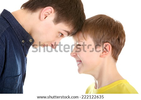 Teenager and Kid looking to each other on the White Background closeup