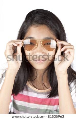 teenager, Asian girl wearing light brown sunglasses. - stock photo
