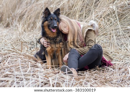 Teenager blonde girl with his friend a dog. - stock photo