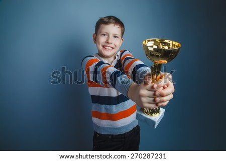 teenager boy brown hair European appearance holds a cup  - stock photo