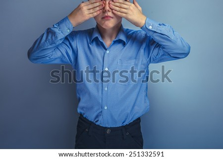 teenager boy Caucasian appearance eyes closed hands unknown - stock photo