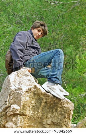 Teenager boy exploring a mountain forest in Majorca