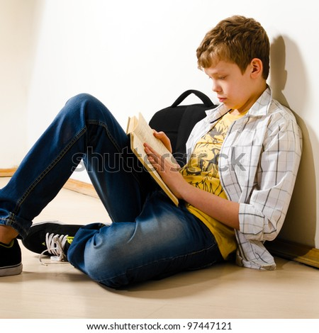 teenager boy is making a homework at school - stock photo