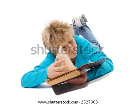 Teenager boy reading an old book; isolated on white