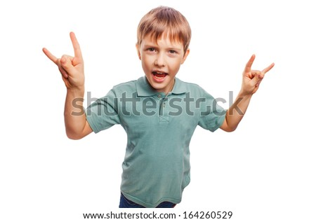 teenager boy shows gesture hands metal rock devil isolated on white background