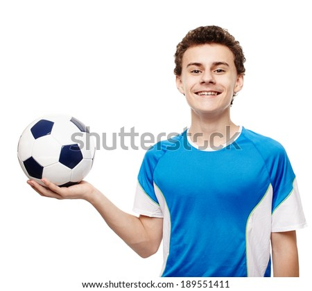 Teenager boy soccer player holding the ball, isolated over white background