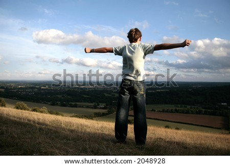 Teenager boy standing on top of Box Hill, England - stock photo
