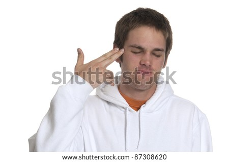 teenager boy with his eyes closed pointing to his head on a white background - stock photo