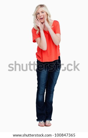 Teenager calling for someone against a white background - stock photo