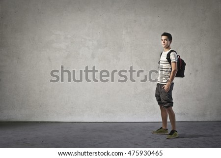 Teenager carrying a backpack