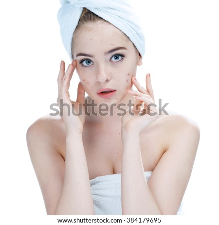 Teenager checking her face for pimple. Woman skin care concept / photos of ugly problem skin girl on white background - stock photo