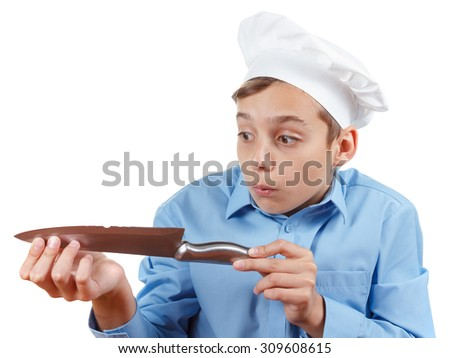 Teenager chef really surprised failure with a knife. Isolated on white - stock photo