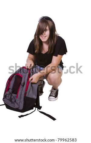 Teenager College Girl with her backpack under a Tree