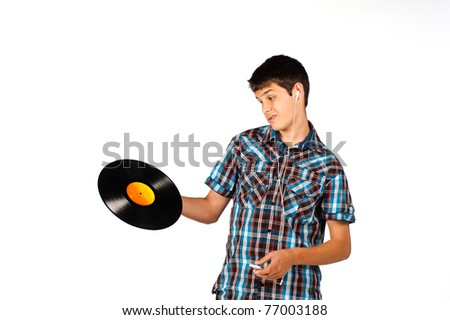 Teenager completely clueless about a vinyl record - stock photo