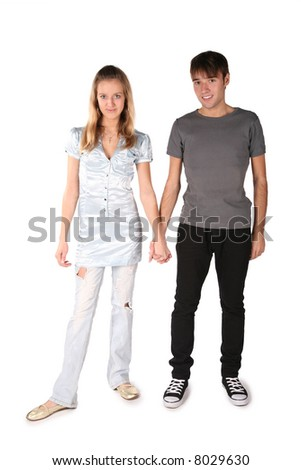 teenager couple is held for the hands on the the white