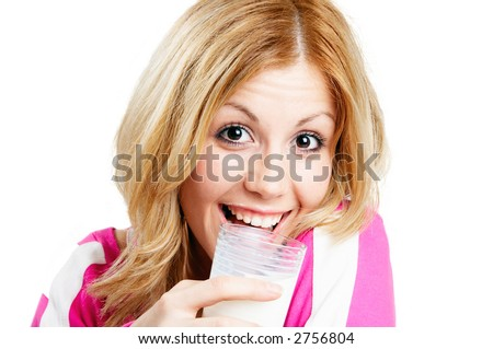 teenager drinking milk in glass - stock photo