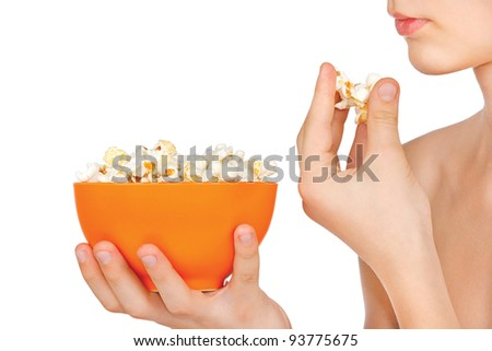 Teenager eating popcorn on a white background - stock photo