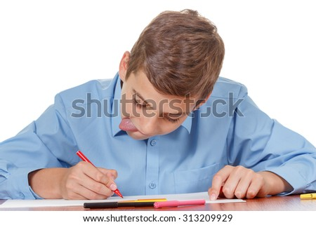 Teenager enthusiastically doing homework on a white background isolate