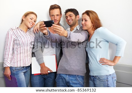 Teenager friends looking together at a smartphone - stock photo