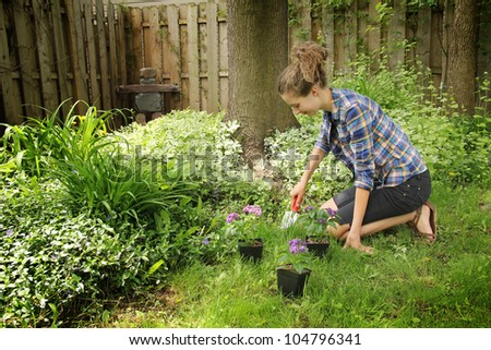 Teenager gardening during a nice summer day