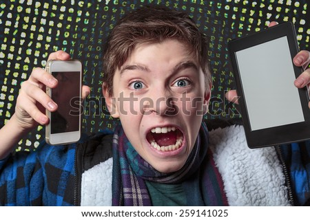 teenager gets crazy with digital media, letters salad background - stock photo