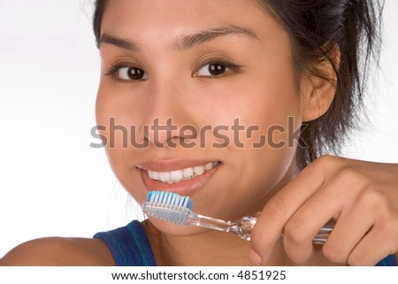 Teenager girl brushes her teeth