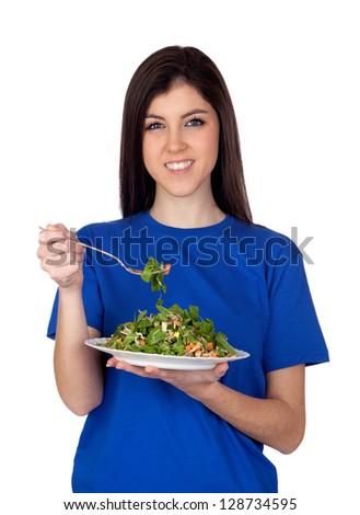 Teenager girl eating vegetables isolated on white background - stock photo