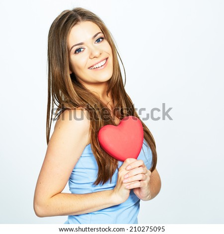 teenager girl hold heart . love concept isolated on white background . - stock photo
