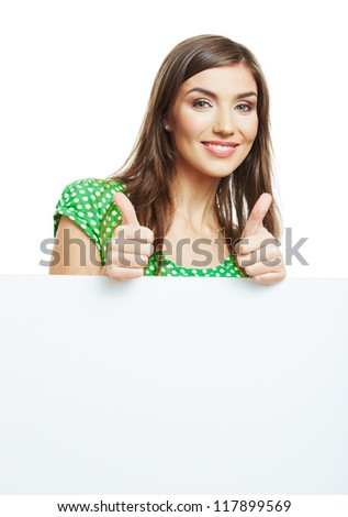 Teenager girl hold white blank paper card. Young smiling woman show blank board. Close up portrait isolated on white background sow thumb up. - stock photo