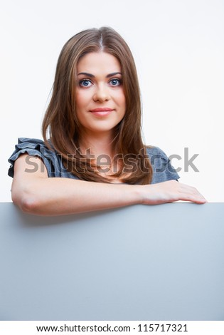 Teenager girl hold white blank paper. Young smiling woman show blank board. Close up female model portrait isolated on white background. - stock photo