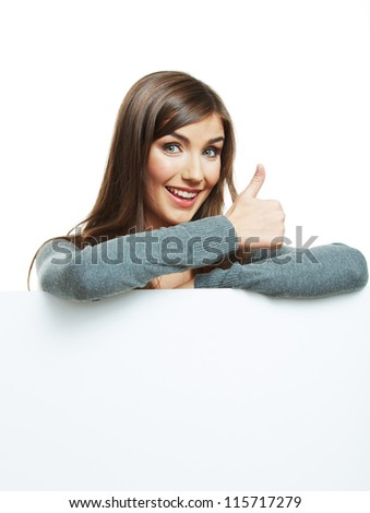 Teenager girl hold white blank paper. Young smiling woman show blank board. Thumb up. - stock photo