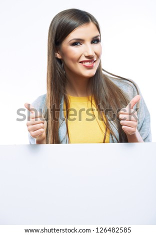 Teenager girl hold white blank paper. Young smiling woman show blank card. Girl portrait isolated on white background. Thumb up.