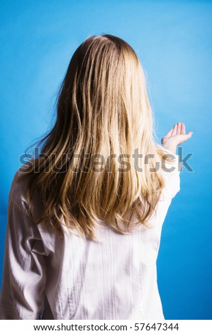 teenager girl holding her hand open - stock photo