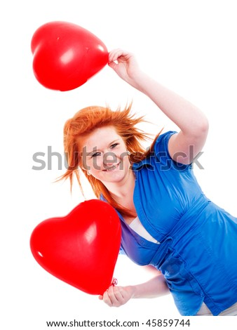 teenager girl holding two valentine balloon hearts over white background
