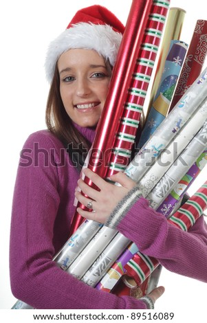 Teenager girl holds Rolls of Christmas gift Wrapping Paper - stock photo