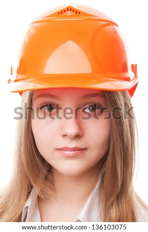 Teenager girl in a hardhat, isolated on a white background