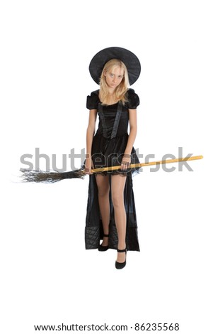 teenager girl in Halloween witch with broom