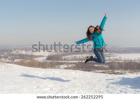 teenager girl jumping in winter, Elabuga, Russia - stock photo