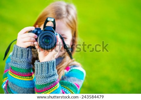 Teenager Girl Learn How to Take Pictures Using DSLR Camera.  - stock photo