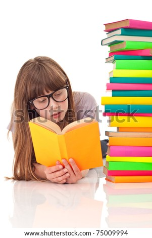teenager girl lying on floor and reading next to pile of books, isolated - stock photo
