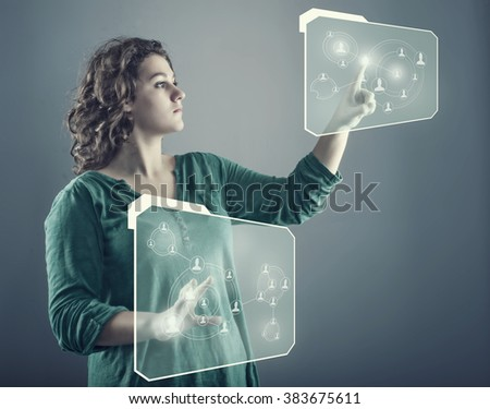 Teenager girl pressing two touch screens with different social network database - stock photo