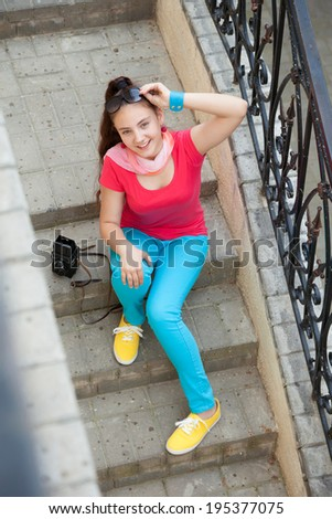 teenager girl sitting on the stairs